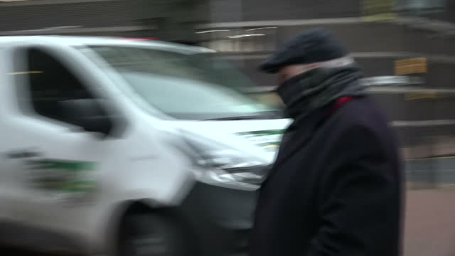 Exterior shots of the liver surgeon Simon Bramhall arriving at Birmingham Crown Court with his face covered for sentencing for burning his initials...