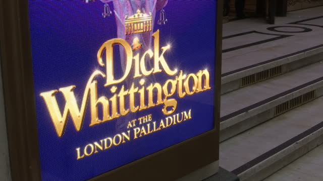 exterior shots of the london palladium theatre with billboards promoting the dick whittington pantomime starring julian clary and other celebrity... - pantomime stock videos and b-roll footage