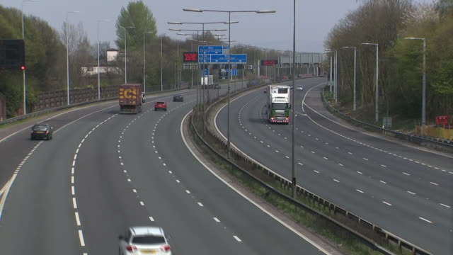 """exterior shots of the m62 motorway with unusually low levels of traffic and shots of digital sign reading """"bank holiday stay home essential travel... - sign stock videos & royalty-free footage"""