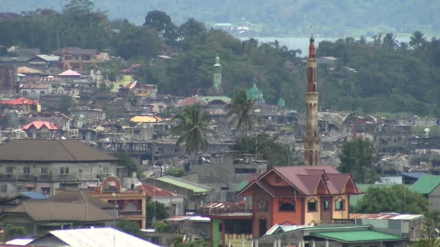 exterior shots of the marawi city skyline, including shots looking towards bomb damaged buildings in the distance on october 31, 2017 in marawi city,... - see other clips from this shoot 31 stock videos & royalty-free footage