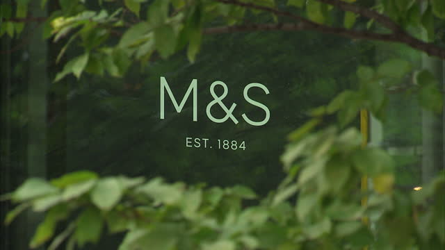 exterior shots of the marks and spencer head office in paddington with corporate signage and clothes and merchandise visible through windows on... - employment issues stock videos & royalty-free footage