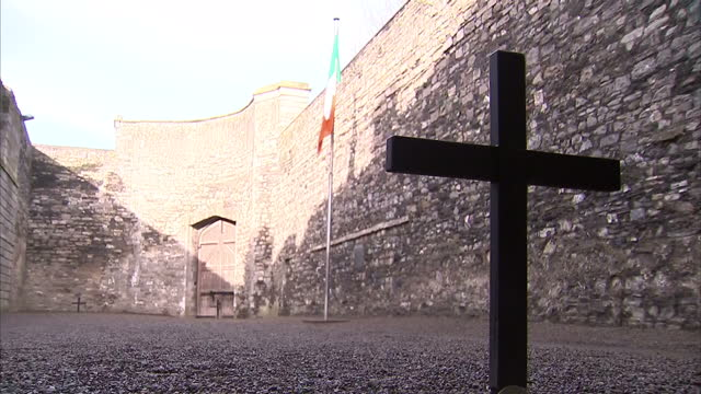 exterior shots of the memorial plaque and cross marking the place where the leaders of the 1916 easter rising were executed in the yard of kilmainham... - memorial plaque stock videos and b-roll footage