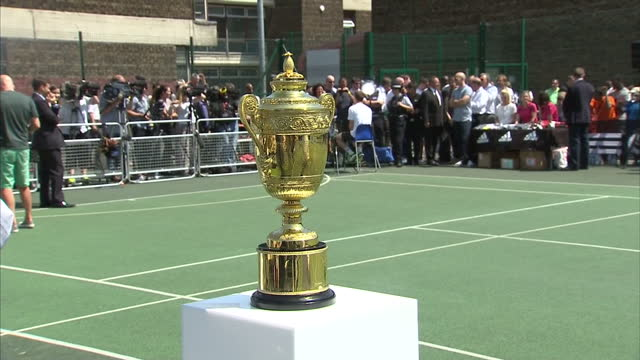 exterior shots of the men's winner of the wimbledon championship trophy close up shots of the names engraved since 2009 wide shots of andy murray... - engraved image stock videos and b-roll footage