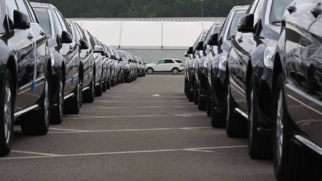 exterior shots of the mercedes benz us international assembly plant in vance alabama us low angle shot between two rows of new mercedes m class... - mercedes benz stock videos & royalty-free footage