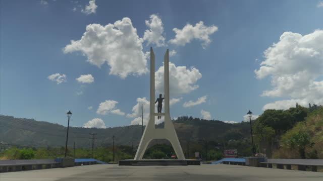 Exterior shots of the Monumento a La Constitución de El Salvado and a pair of trainers slung over a telegraph line on April 04 2018 in San Salvador...