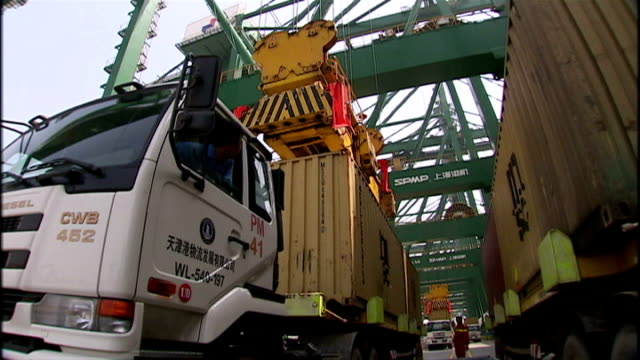 exterior shots of the msc luciana docked at container port being loaded up by dock workers and huge cranes with shipping containers on august 12,... - film container stock videos & royalty-free footage