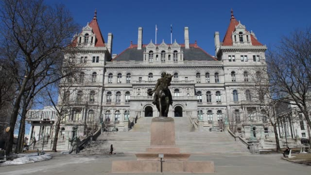exterior shots of the new york state capitol building in albany new york with a horse statue out front - albany new york state stock videos & royalty-free footage