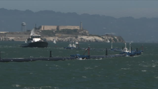 vidéos et rushes de exterior shots of the ocean clean up foundations floating system on september 08, 2018 in san francisco, california. - clean