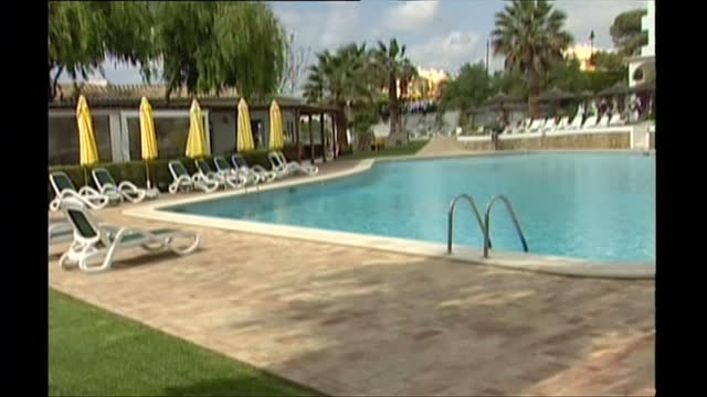 exterior shots of the ocean club apartments after the disappearance of madeleine mccann including the swimming pool, children's toys and a creche... - madeleine mccann stock videos & royalty-free footage