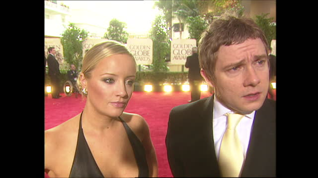 exterior shots of the office sitcom actors lucy davis and martin freeman being interviewed on the golden globes red carpet before the award ceremony... - 2004 stock videos & royalty-free footage