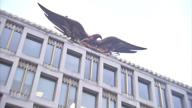 Exterior shots of the old US embassy building in Grosvenor Square including views of the large bald eagle sculpture on the embassy roof on January 12...
