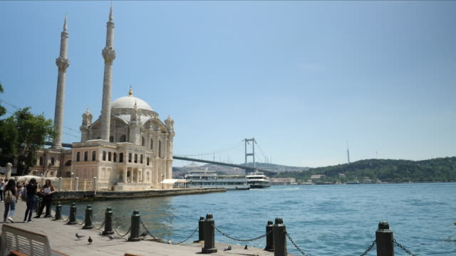exterior shots of the ortakoy mosque bridge over the bosphorus on 20 june 2018 in istanbul turkey - ortakoy mosque stock videos and b-roll footage