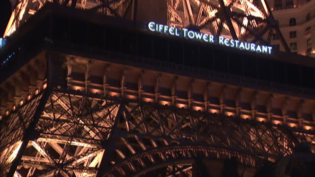 exterior shots of the paris hotel and casino featuring a scaled down replica of the eiffel tower clip is mute due to music clearance issues on... - replica eiffel tower stock videos & royalty-free footage