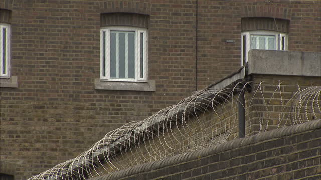 exterior shots of the perimeter walls and signs warning of throwing items over the walls of pentonville prison on 17 april 2017 in london united... - federal prison stock videos & royalty-free footage