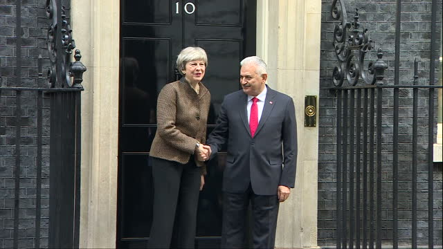Exterior shots of the Prime Minister of Turkey Binali Yildirim arriving at Downing Street and posing for a photocall with Theresa May before both...