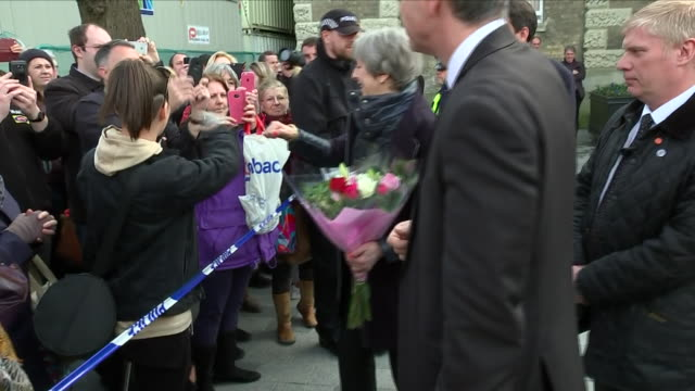 stockvideo's en b-roll-footage met exterior shots of the prime minister theresa may gives a woman in the crowd a fist bump during her visit on 15th march 2018 in salisbury united... - wiltshire