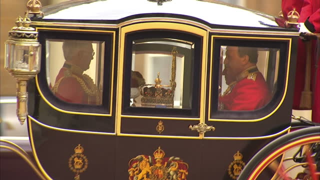 exterior shots of the queen alexandra stage coach carrying the royal regalia the imperial state crown the cap of maintenance and the sword of state... - state opening of uk parliament stock videos & royalty-free footage