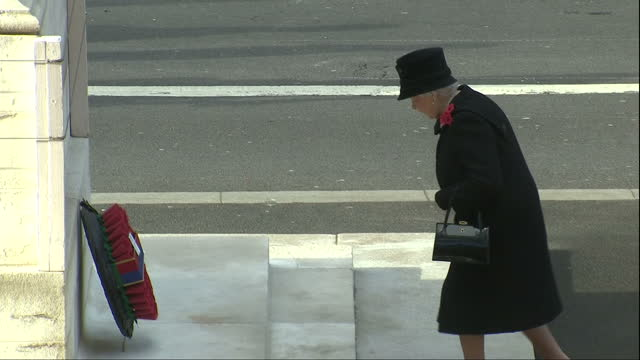 exterior shots of the queen and duke of edinburgh laying wreaths at the base of the cenotaph on november 13 2016 in london england - remembrance sunday stock videos & royalty-free footage