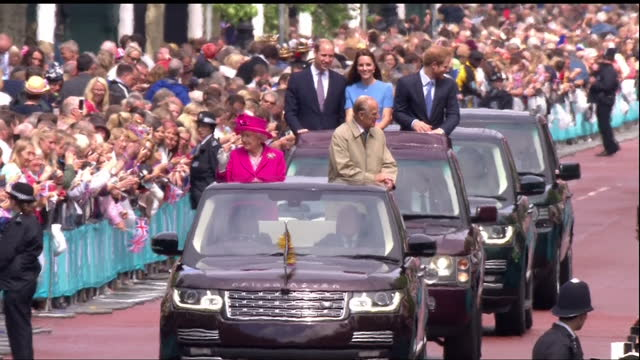exterior shots of the queen and prince philip waving from the back of an opentop range rover to cheering crowds on the mall followed by prince... - queen royal person stock videos & royalty-free footage