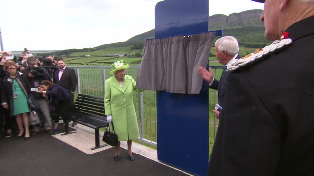 Exterior shots of the Queen arriving at Bellarena station unveiling a commemorative plaque to mark the stations official opening and greeting local...