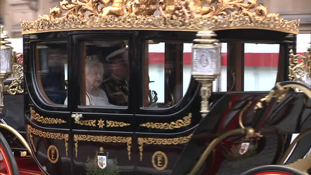 exterior shots of the queen arriving at the sovereign's entrance, palace of westminster for the state opening of parliament. queen arriving for state... - parliament building stock videos & royalty-free footage