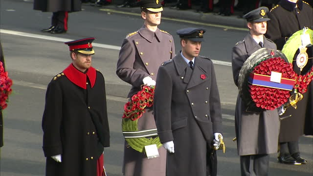 exterior shots of the queen duke of edinburgh and princes william and harry stood in silence at the cenotaph on november 13 2016 in london england - remembrance day stock videos & royalty-free footage