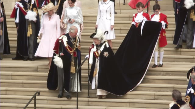 exterior shots of the queen elizabeth ii departing st george's chapel after the royal order of the garter service and gets into horse drawn carriage... - britisches königshaus stock-videos und b-roll-filmmaterial