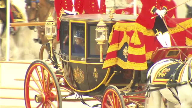 exterior shots of the queen inside a glass carriage leaving horse guards parade after trooping the colour celebrations queen departing trooping the... - carriage stock videos and b-roll footage