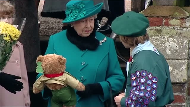 exterior shots of the queen on christmas day receiving gifts from children including a scouting teddy bear from a scout with lots of achievement... - テディベア点の映像素材/bロール