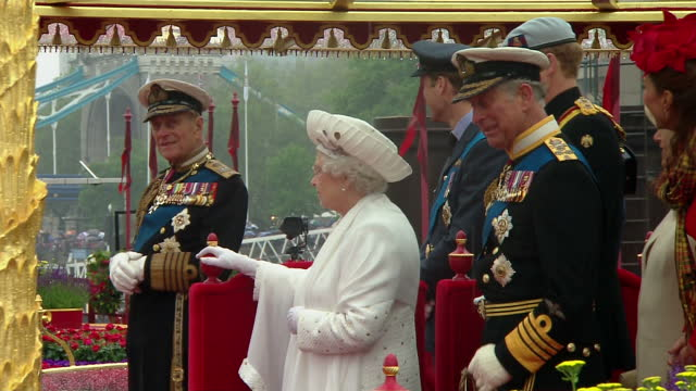 exterior shots of the queen prince philip duke of edinburgh and prince charles camilla dancing to pageant music on the royal barge as part of the... - queen royal person stock videos & royalty-free footage