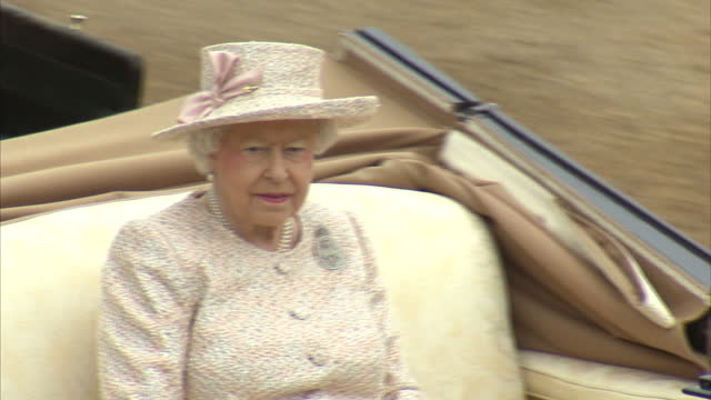 exterior shots of the queen riding in an open carriage inspecting guardsmen on parade before the trooping the colour ceremony, followed by prince... - elizabeth ii stock videos & royalty-free footage