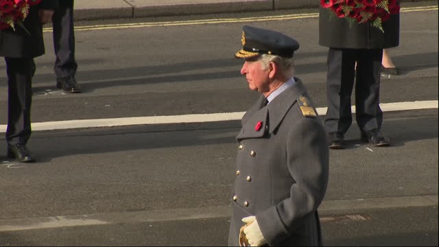 exterior shots of the queen stood on a whitehall balcony and prince charles stood as bells toll for two minute's silence on remembrance sunday at the... - remembrance sunday stock videos & royalty-free footage