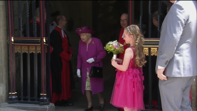 stockvideo's en b-roll-footage met exterior shots of the queen walking from westminster abbey on a visit to officially launch the queen's diamond jubilee galleries, being presented... - westminster abbey