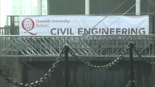 Exterior shots of the Queen's University Belfast with a Civil Engineering banner and a bridge made of Meccano over Clarendon Dock on September 19...
