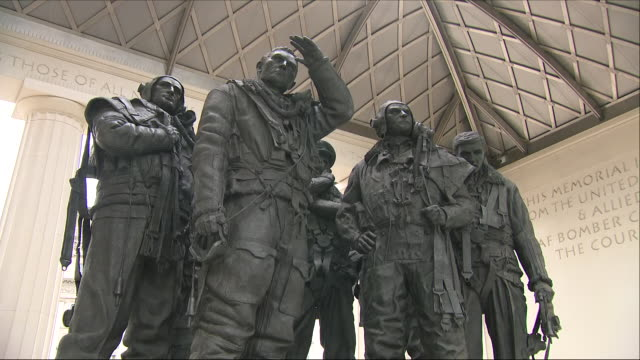 exterior shots of the raf bomber command memorial including close up shots of the 53 white flight gloves left in memory to mark the 75th anniversary... - raf stock videos and b-roll footage