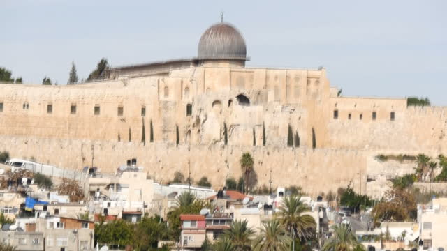 exterior shots of the rear of the al aqsa mosque complex and gold domed dome of the rock with shots of the rooftops of houses in the village of... - dome stock videos & royalty-free footage