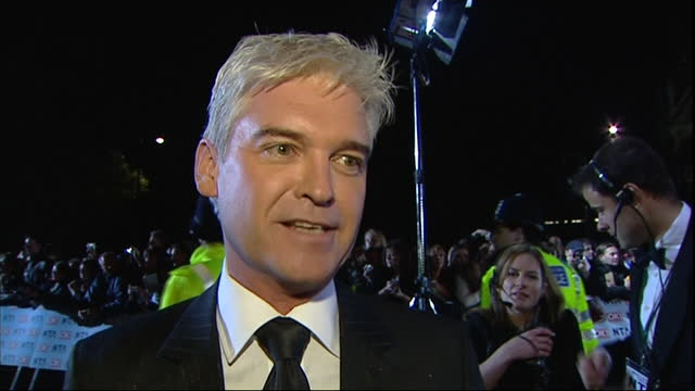 exterior shots of the red carpet arrivals of the 2006 national television awards at the royal albert hall, with television presenter phillip... - phillip schofield stock videos & royalty-free footage
