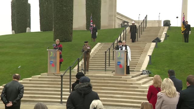 exterior shots of the remembrance sunday service taking place at the national memorial arboretum with attendees sat in socially distanced pairs as... - national memorial arboretum stock videos & royalty-free footage