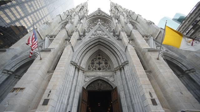 exterior shots of the restoration project at st patricks cathedral in midtown manhattan new york us on april 7th 2015 shots exterior shots pan up and... - st. patrick's cathedral manhattan stock videos and b-roll footage