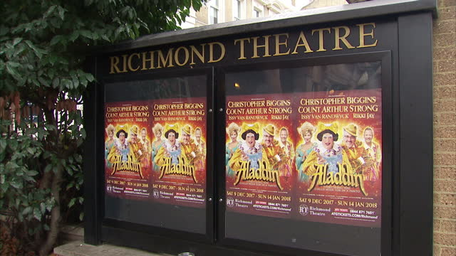 exterior shots of the richmond theatre and a billboard outside promoting the aladdin christmas pantomime starring christopher biggins and count... - pantomime stock videos and b-roll footage