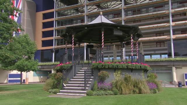 exterior shots of the royal ascot bandstand shadowing the paddock. - イギリス アスコット競馬場点の映像素材/bロール