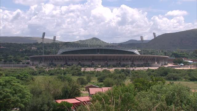 exterior shots of the royal bafokeng stadium the surorunding area including makeshift homes made of corrugated metal bafokeng stadium in rustenburg... - resourceful stock videos & royalty-free footage