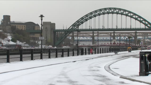 exterior shots of the sage building and gateshead millennium bridge with snow covering the walkway running along the river tyne on 17th march 2018 in... - gateshead stock videos and b-roll footage