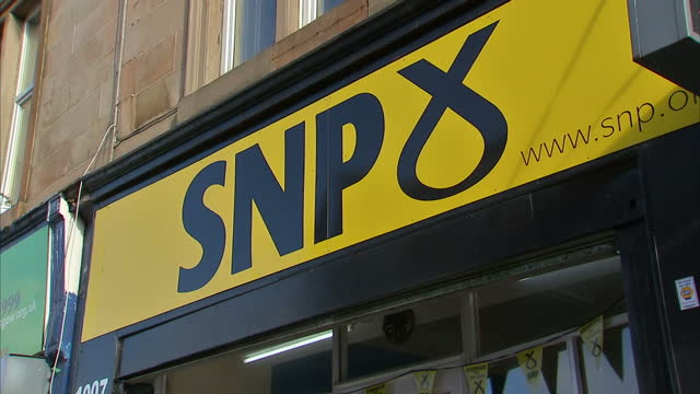 Exterior shots of the SNP offices Glasgow Cathcart branch a poster of Nicola Sturgeon and other posters including slogans 'In' 'Stronger for...