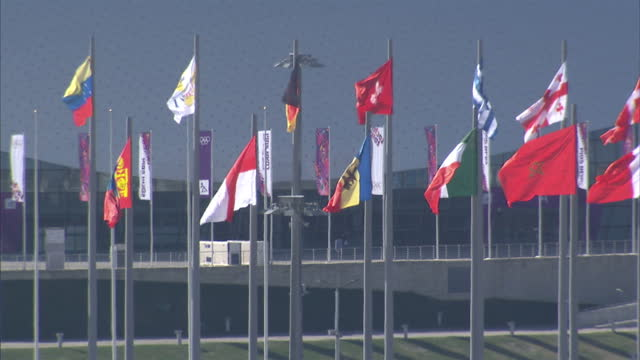 vídeos y material grabado en eventos de stock de exterior shots of the sochi olympic park including the ice cube curling centre and the fisht stadium>> on february 05 2014 in sochi russia - sochi