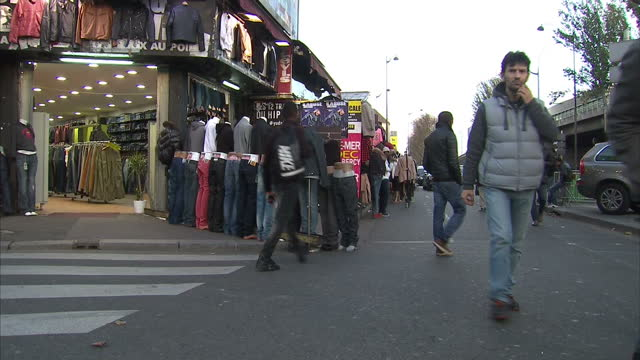 exterior shots of the st denis area of paris, with people walking past various budget clothing shops on november 18, 2015 in paris, france. - variation stock videos & royalty-free footage