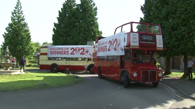 exterior shots of the st helens open top buses with a banner on the side reading 'challenge cup winners 2021'. ahead of their 2021 trophy parade. - double decker bus stock videos & royalty-free footage