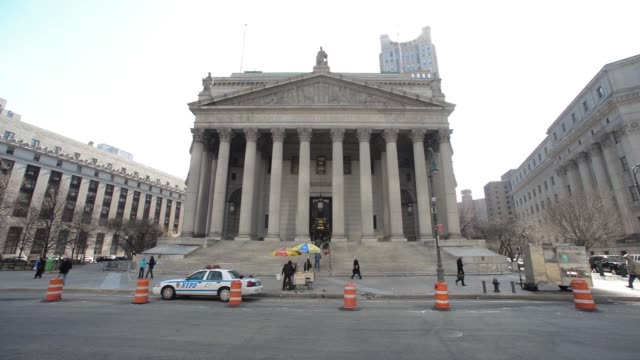 Exterior shots of the State Supreme Court at 60 Centre Street in Manhattan New York US Shots pan down from the sky to the columns lining the entrance...