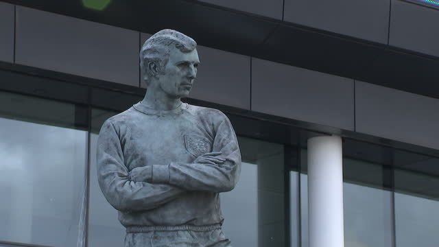 exterior shots of the statue of bobby moore outside wembley stadium and the british royal standard flying to mark prince william's visit>> on april... - football association stock videos & royalty-free footage