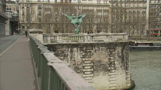 exterior shots of the statue of 'la france renaissante' on the pont de birhakeim and views of the paris skyline next to the river seine general views... - pont de bir hakeim stock videos & royalty-free footage